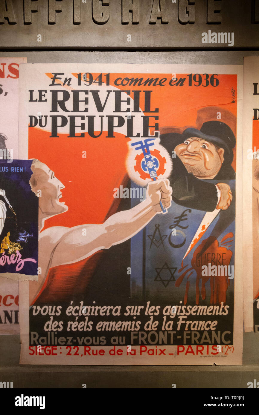 World War Two German propaganda posters urging the French to support the invading troops, Mémorial de Caen (Caen Memorial), Normandy, France. - Stock Image