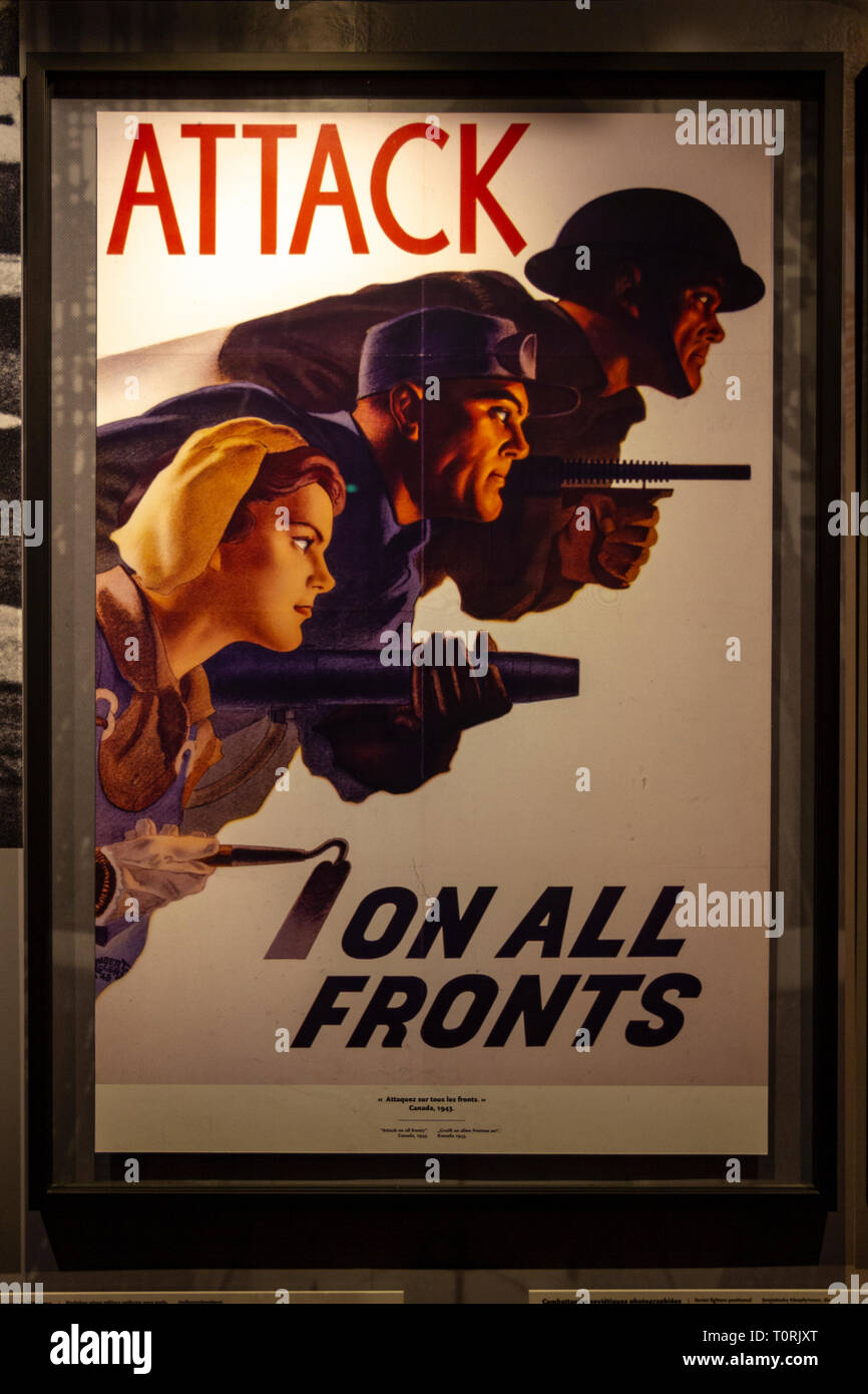 A Canadian World War Two propaganda poster 'Attack On All Fronts', Mémorial de Caen (Caen Memorial), Normandy, France. - Stock Image