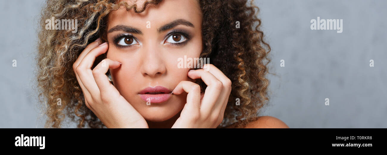 A beautiful black woman portrait. Tests the emotion of bewilderment - Stock Image