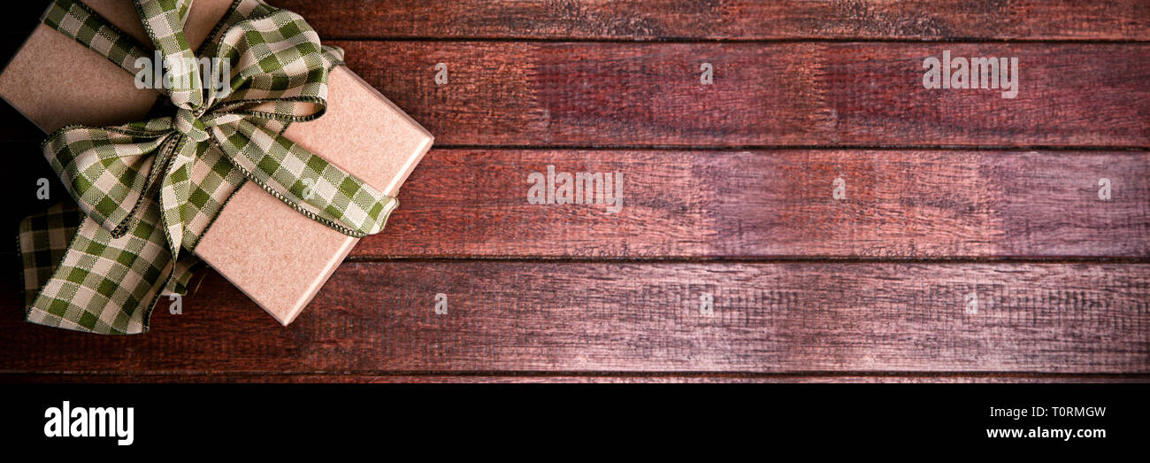 Gift box on wooden table - Stock Image