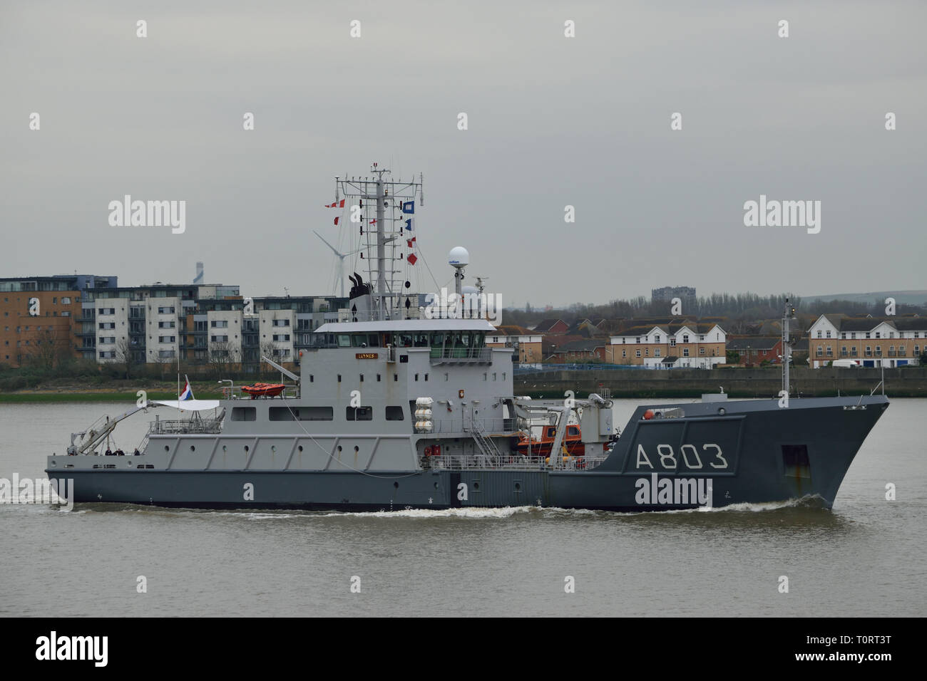 Royal Netherlands Navy hydrographic survey vessel HNLMS Luymes heads up the River Thames to London on a courtesy visit - Stock Image