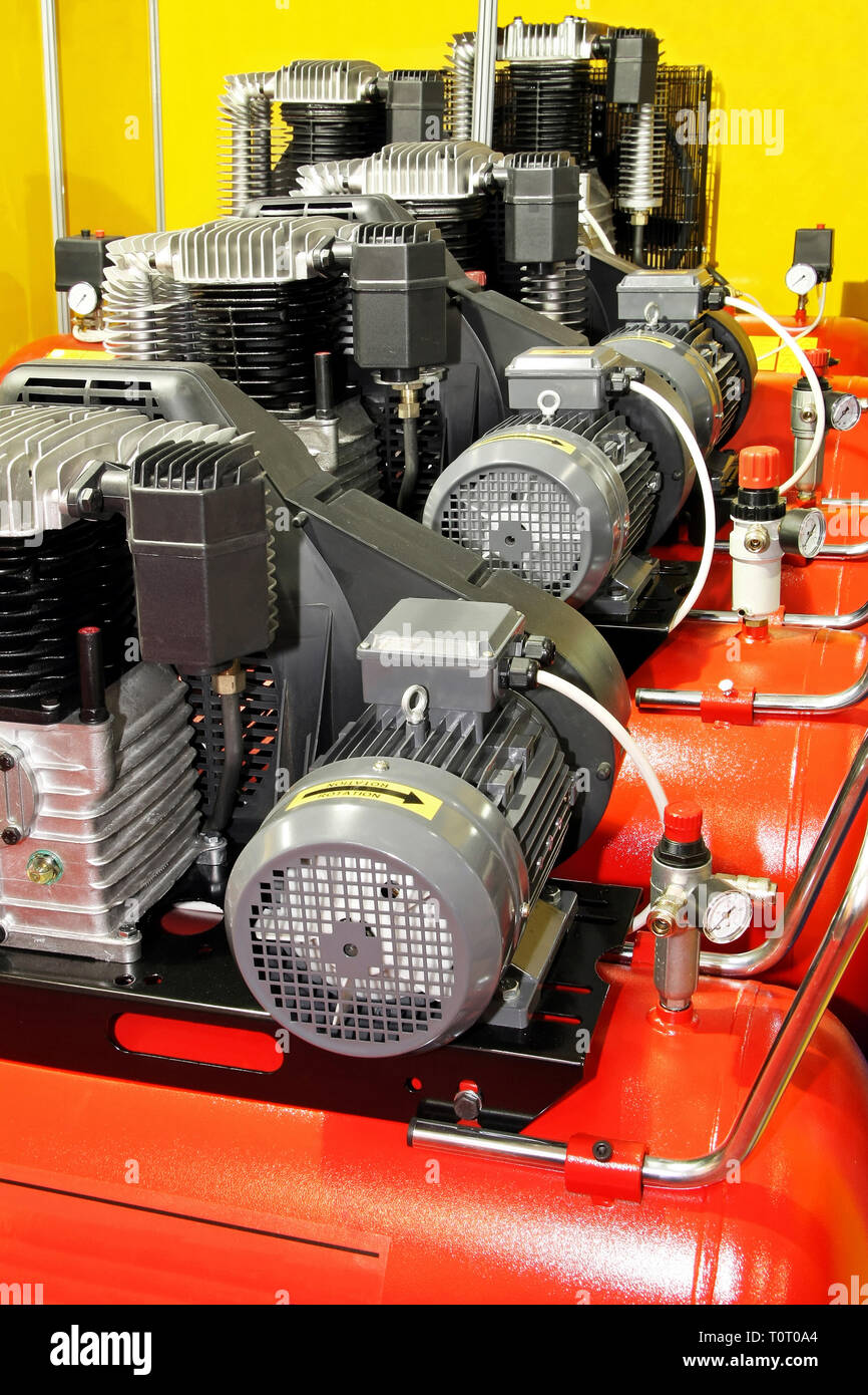 Several red powerful air compressors in line Stock Photo