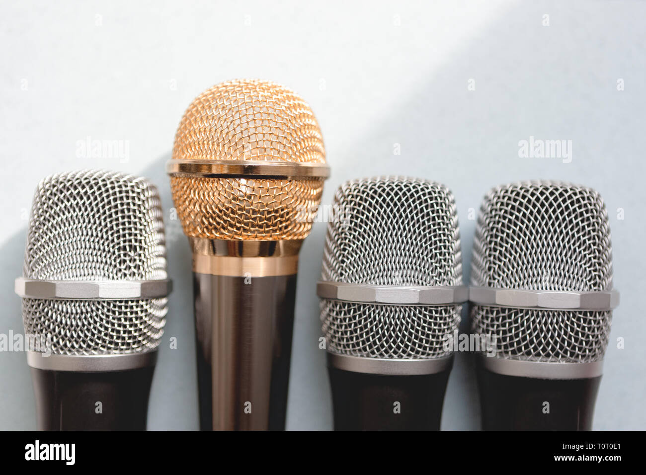 leadership concept. group of microphones with golden one. freedom to speak up concept. - Stock Image