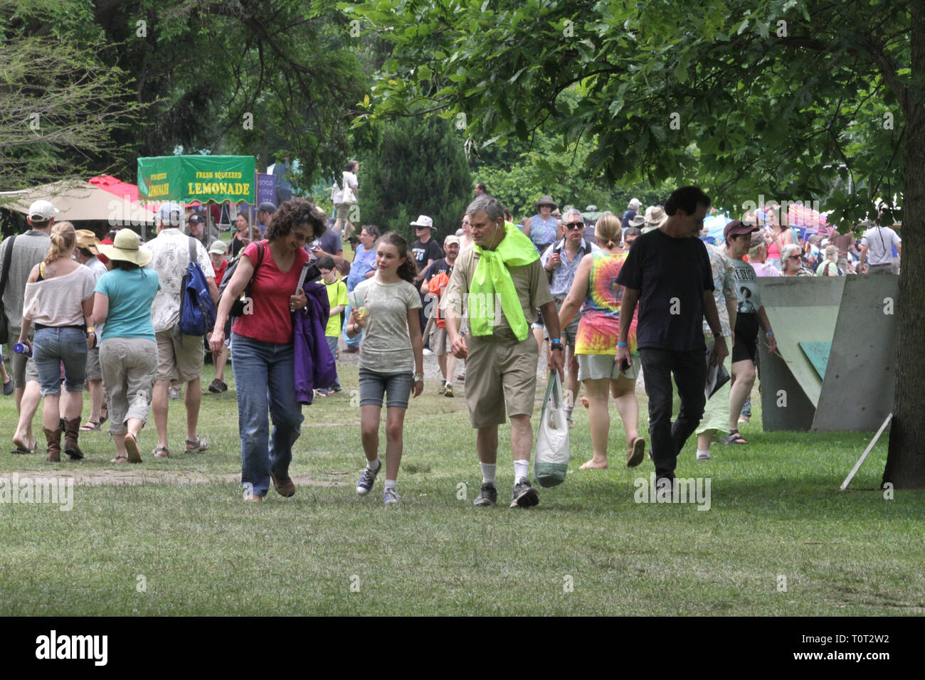 Concert goers are shown on the move during a summer outdoor music festival event. Stock Photo