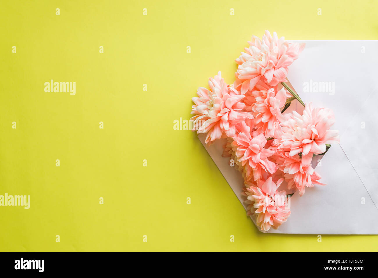 Pink Flowers Envelope On Yellow Background Wedding