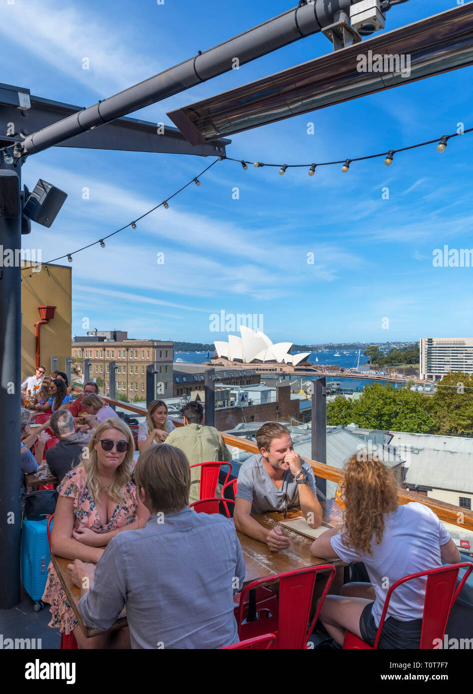 Rooftop bar of the Glenmore Hotel with the Sydney Opera House in the distance, The Rocks, Sydney, Australia - Stock Image