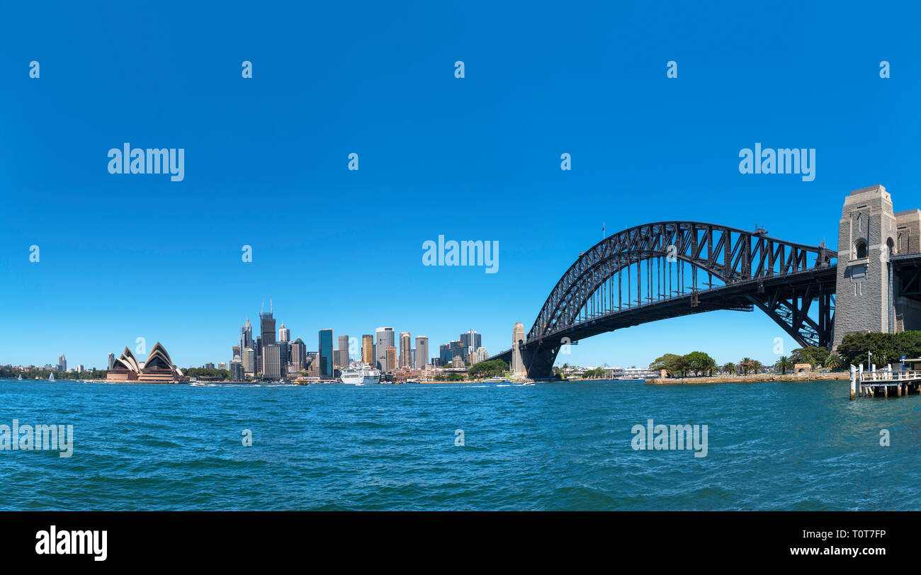Panoramic view of Sydney Harbour Bridge, Sydney Opera House and the Central Business District skyline from Kirribilli, Sydney, Australia - Stock Image