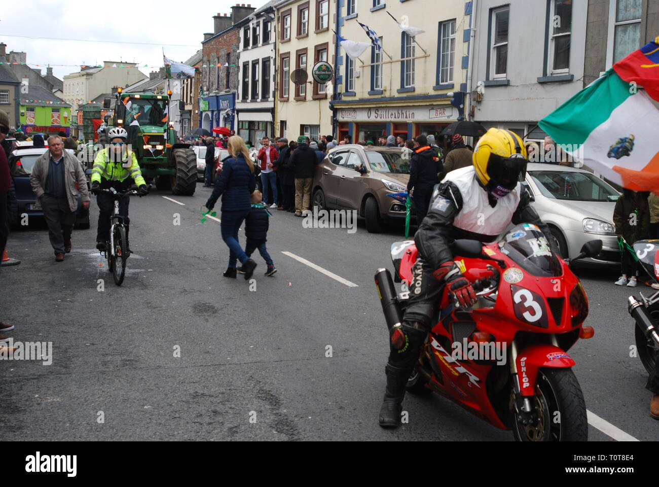 Garda on push Bike tries to catch a motorcycle Stock Photo