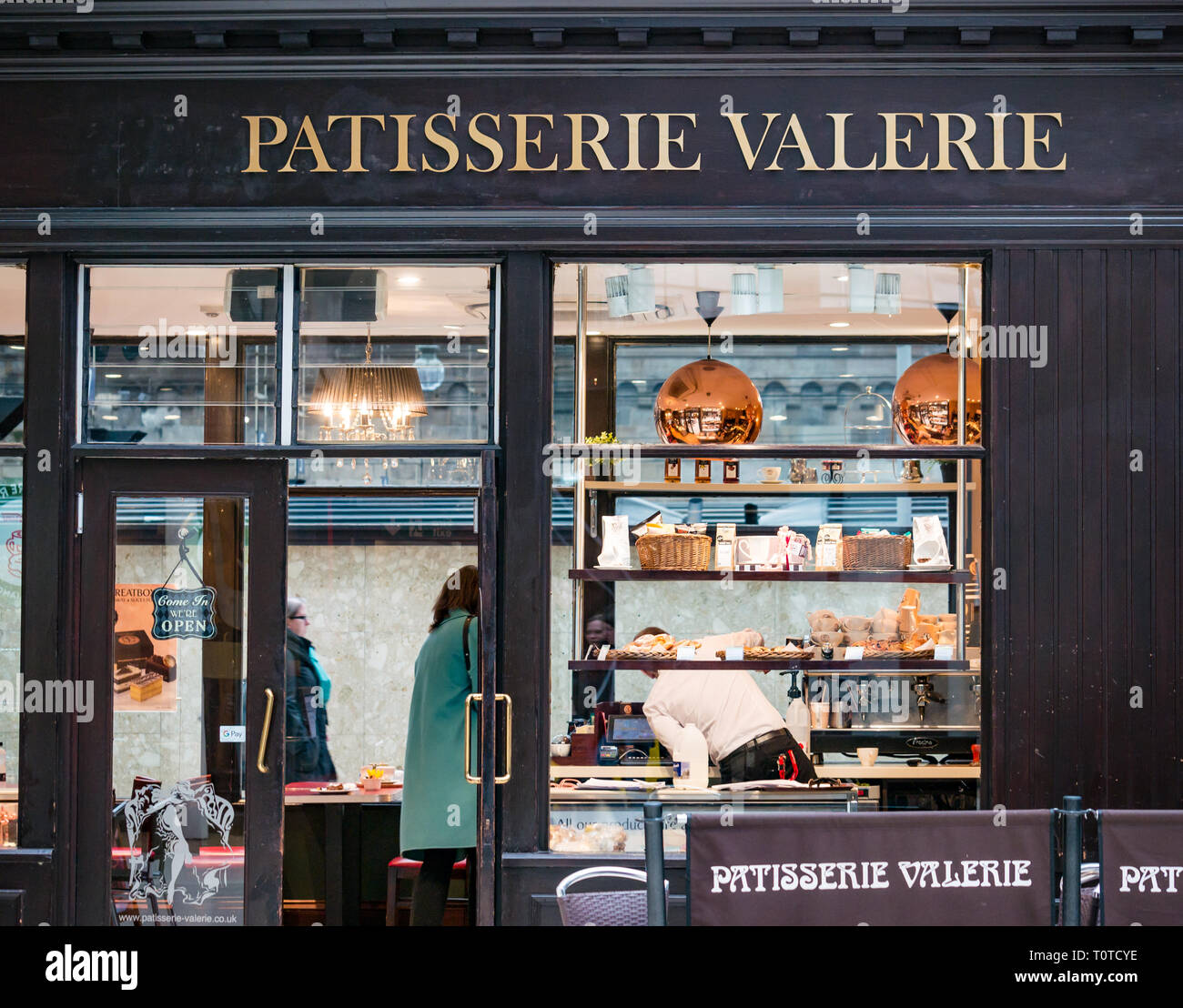 Customer in Patisserie Valerie, Glasgow Central Station concourse, Scotland, UK - Stock Image
