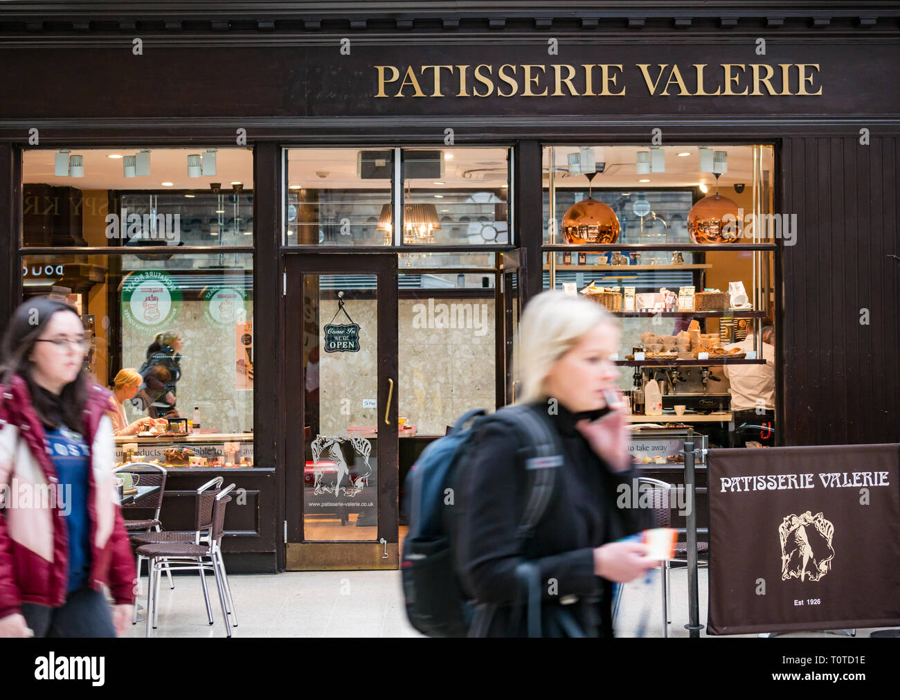 People passing Patisserie Valerie, Glasgow Central Station concourse, Scotland, UK - Stock Image