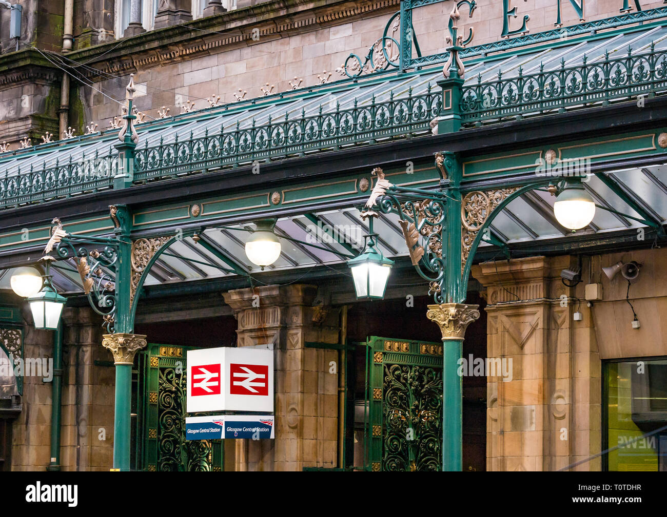 Ornate Victorian ironwork and lights at entrance of Glasgow Central Station, Scotland, UK - Stock Image