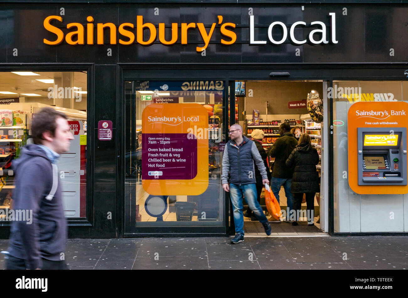 People going in and out of Sainsbury's Local grocery shop, Argyle Street, Glasgow, Scotland, UK - Stock Image