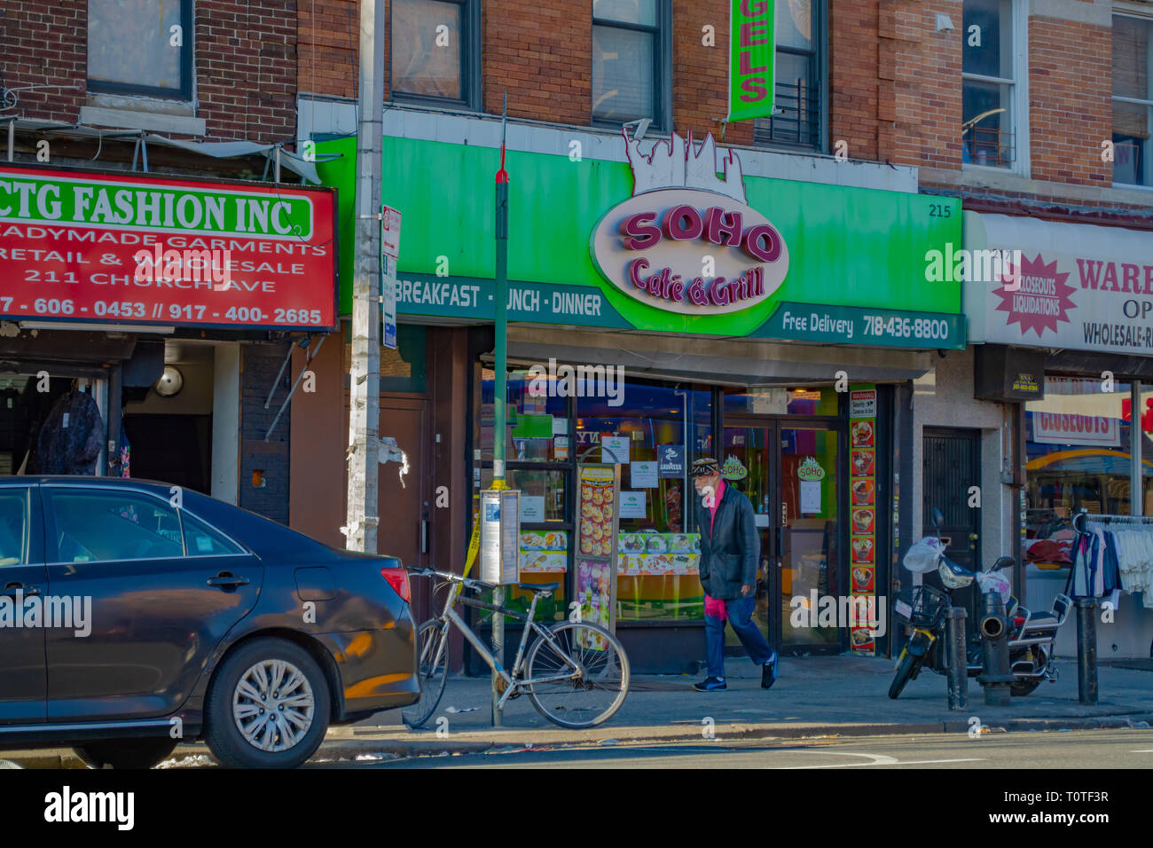 Bangladeshi man is walking through the streets of Brooklyn near the Soho Cafe and Grill. Brooklyn, NY spring 2019 - Stock Image