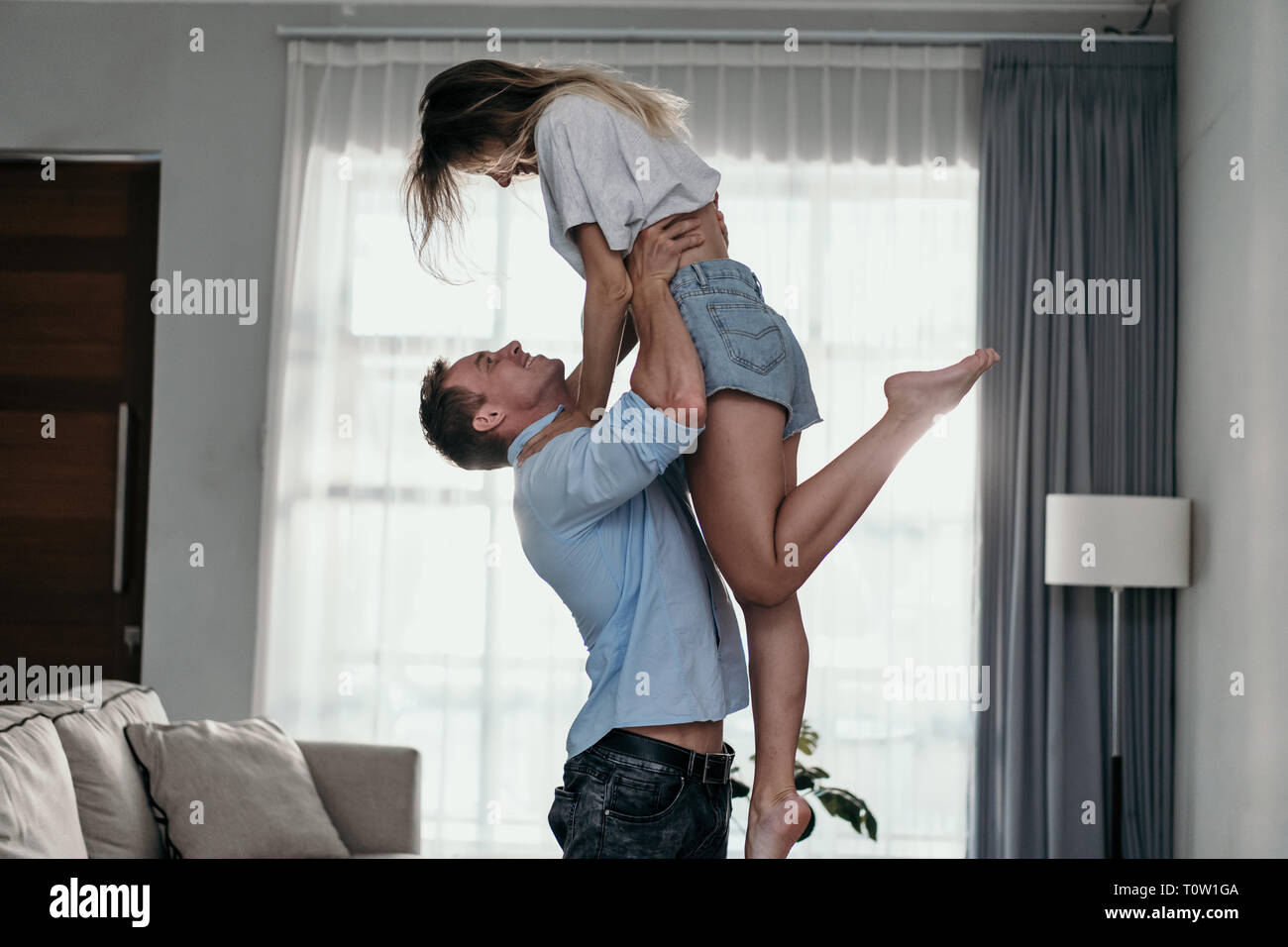 young couple in love having fun and dancing - Stock Image