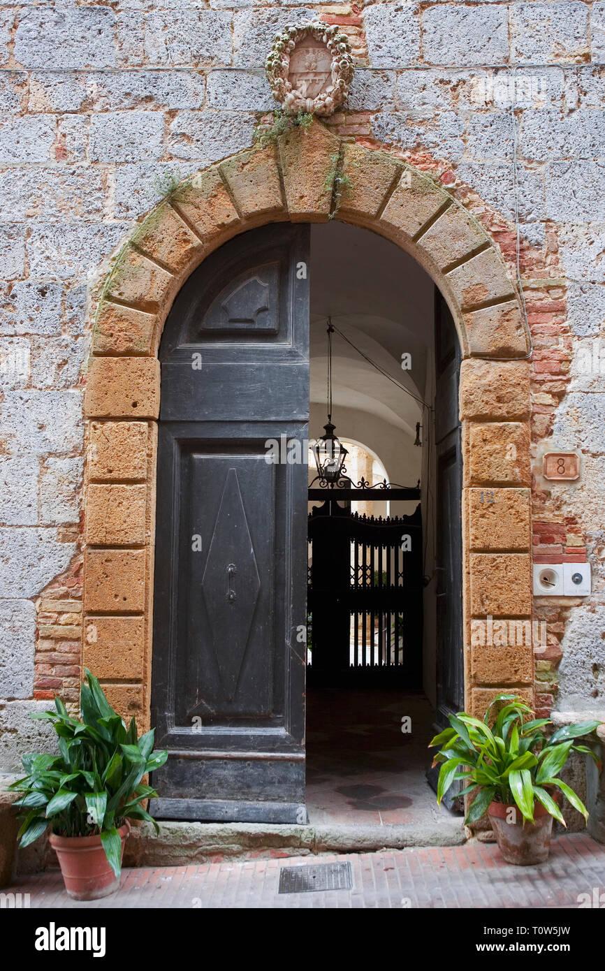 Posh doorway, Via del Castello, San Gimignano, Tuscany, Italy Stock Photo