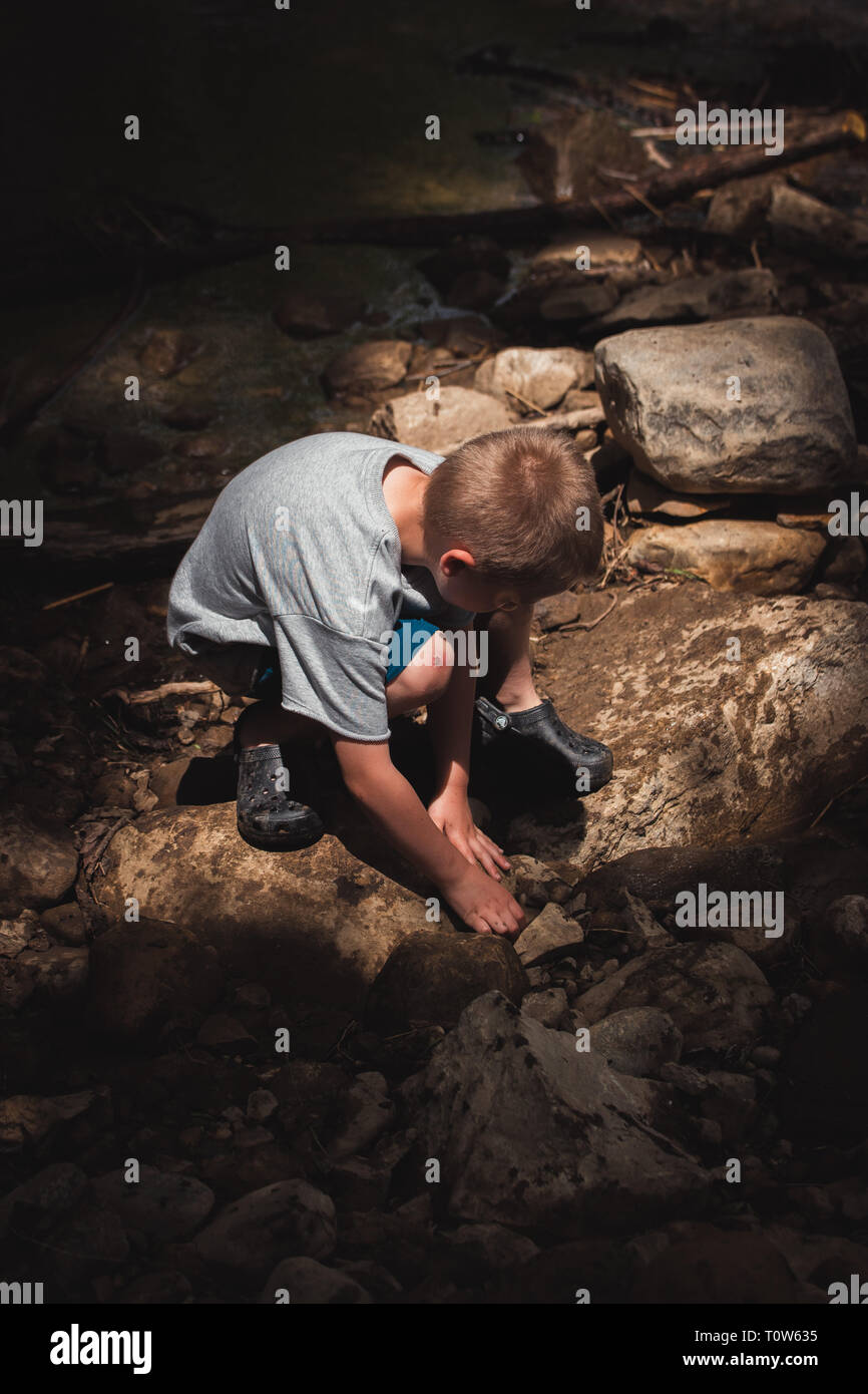Boy Playing in Dirt - Stock Image