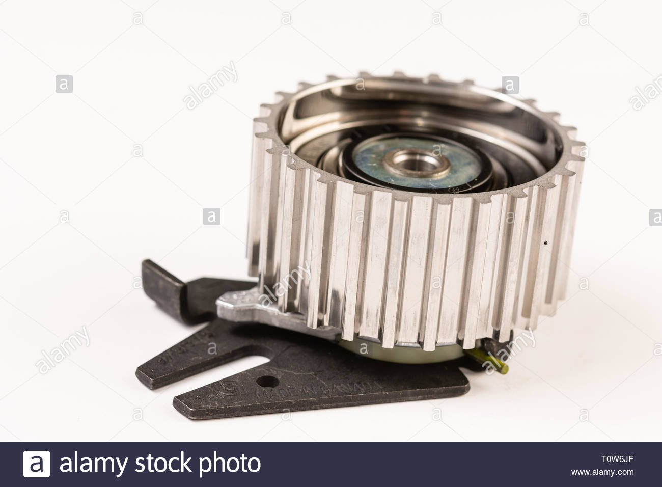 Timing belt gear wheel above white background - Stock Image