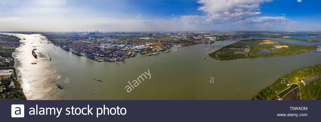 View aerial of Cat Lai port container, Ho Chi Minh City with development buildings, transportation, energy power infrastructure. View from Dong Nai - Stock Image