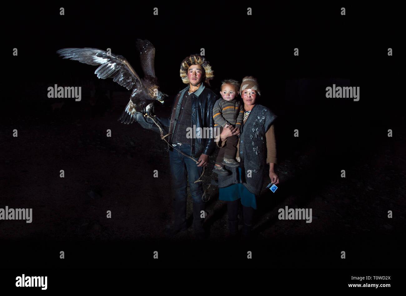bayan Ulgii, Mongolia, 30th September 2015: family of mongolian kazakh eagle hunters at night Stock Photo