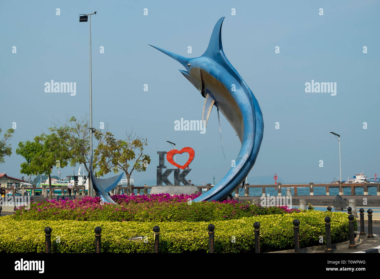 A big marlin statue marks one of the main roundabouts in Kota Kinabalu, Sabah, Borneo, Malaysia. - Stock Image