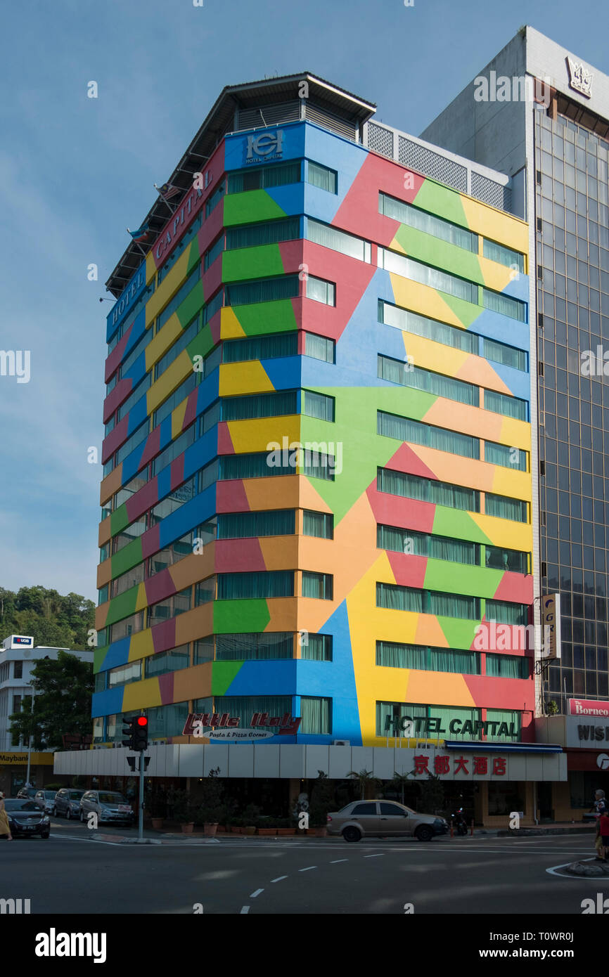 A rainbow, multicolored building is located downtown in Kota Kinabalu, Sabah, Borneo, Malaysia. - Stock Image
