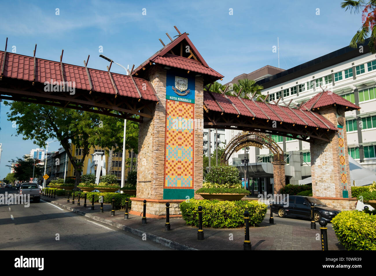 The gate to the city, decorated in traditional motifs, in Kota Kinabalu, Sabah, Borneo, Malaysia. - Stock Image