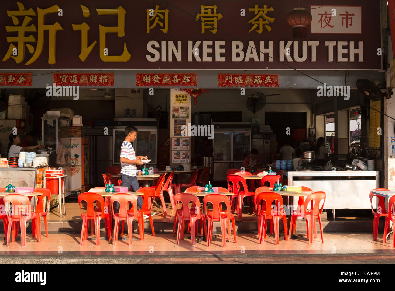 The typical eating style in Kota Kinabalu, Sabah, Borneo, Malaysia, outside. - Stock Image