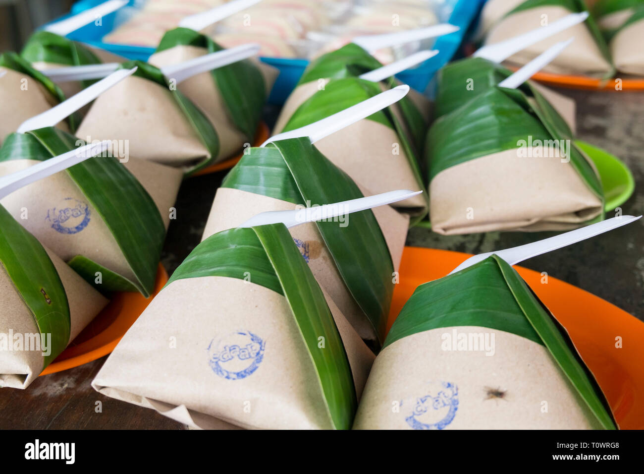 The rice breakfast dish, nasi lemak, all wrapped up and for sale at a cafe in Kota Kinabalu, Sabah, Borneo, Malaysia. - Stock Image