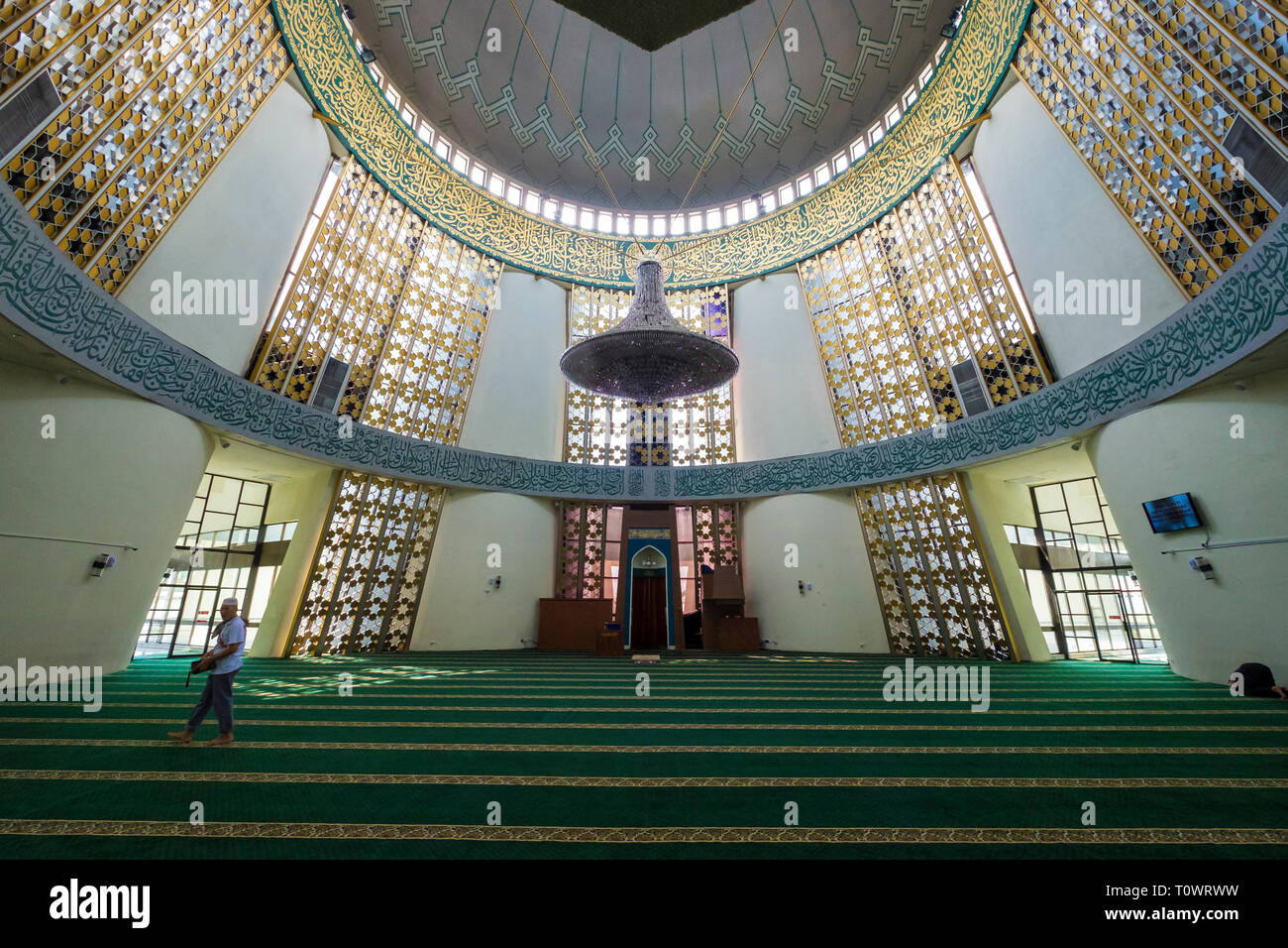 The Sabah State Mosque in Kota Kinabalu, Sabah, Borneo, Malaysia. Interior view of the large, round space. - Stock Image