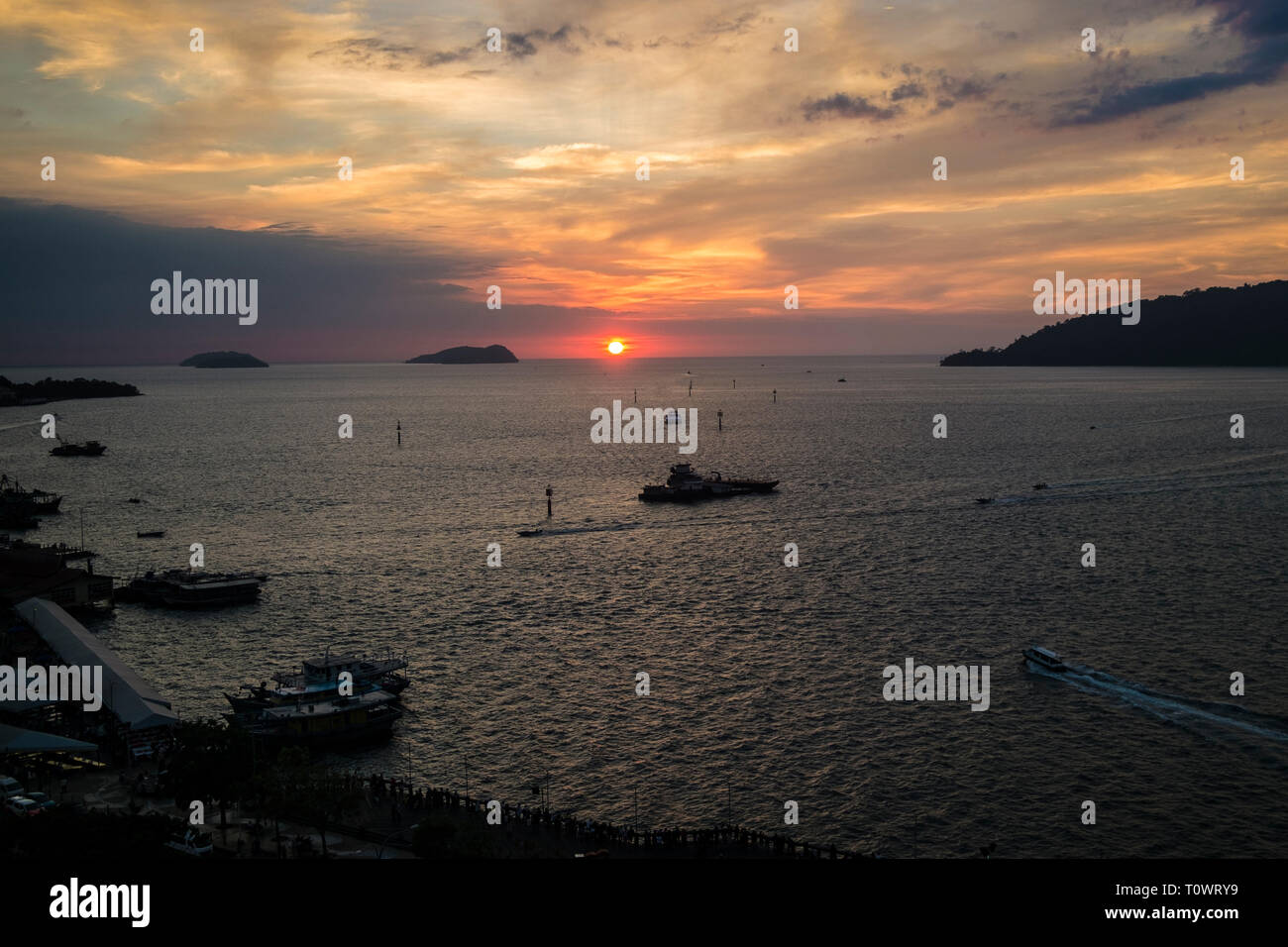 A stunning, beautiful, orange sunset with sun ball over the South China Sea in Kota Kinabalu, Sabah, Borneo, Malaysia. - Stock Image