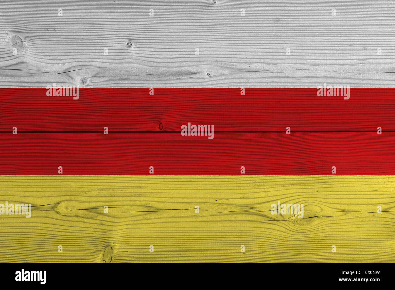south ossetia flag painted on old wood plank - Stock Image