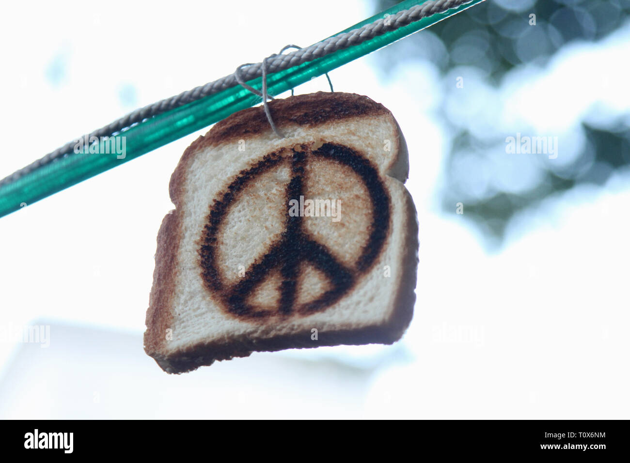 A peace sign is shown toasted on a slice of white bread and on display at the Mountain Jam music festival. - Stock Image