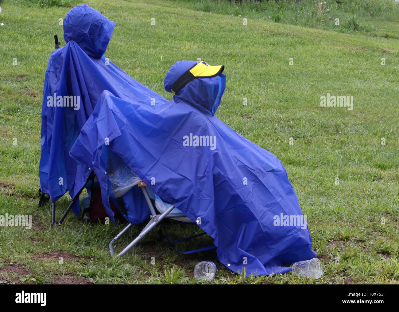 Poncho Pair is shown sitting on Hunter Mountain during the Mountain Jam music festival. - Stock Image