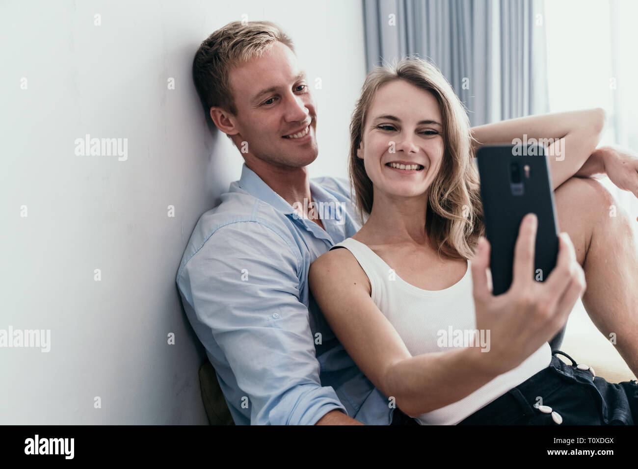 young lovely couple take selfie together - Stock Image