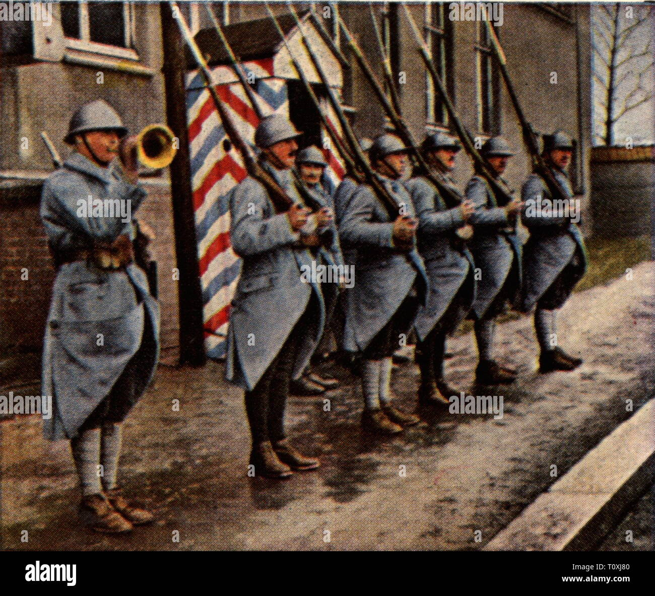 politics, Inter-Allied occupation for safeguarding the plebiscite in Upper Silesia, French guard in Katowice, January 1920, coloured photograph, cigarette card, series 'Die Nachkriegszeit', 1935, Katowice, Poland, Silesia, clause of the treaty of Versailles, Treaty of Versailles, military, Entente, French, soldiers, soldier, people, Prussia, Germany, German Reich, Weimar Republic, 1920s, 20th century, politics, policy, plebiscite, national referendum, coloured, colored, post war period, post-war period, post-war years, post-war era, historic, his, Additional-Rights-Clearance-Info-Not-Available - Stock Image