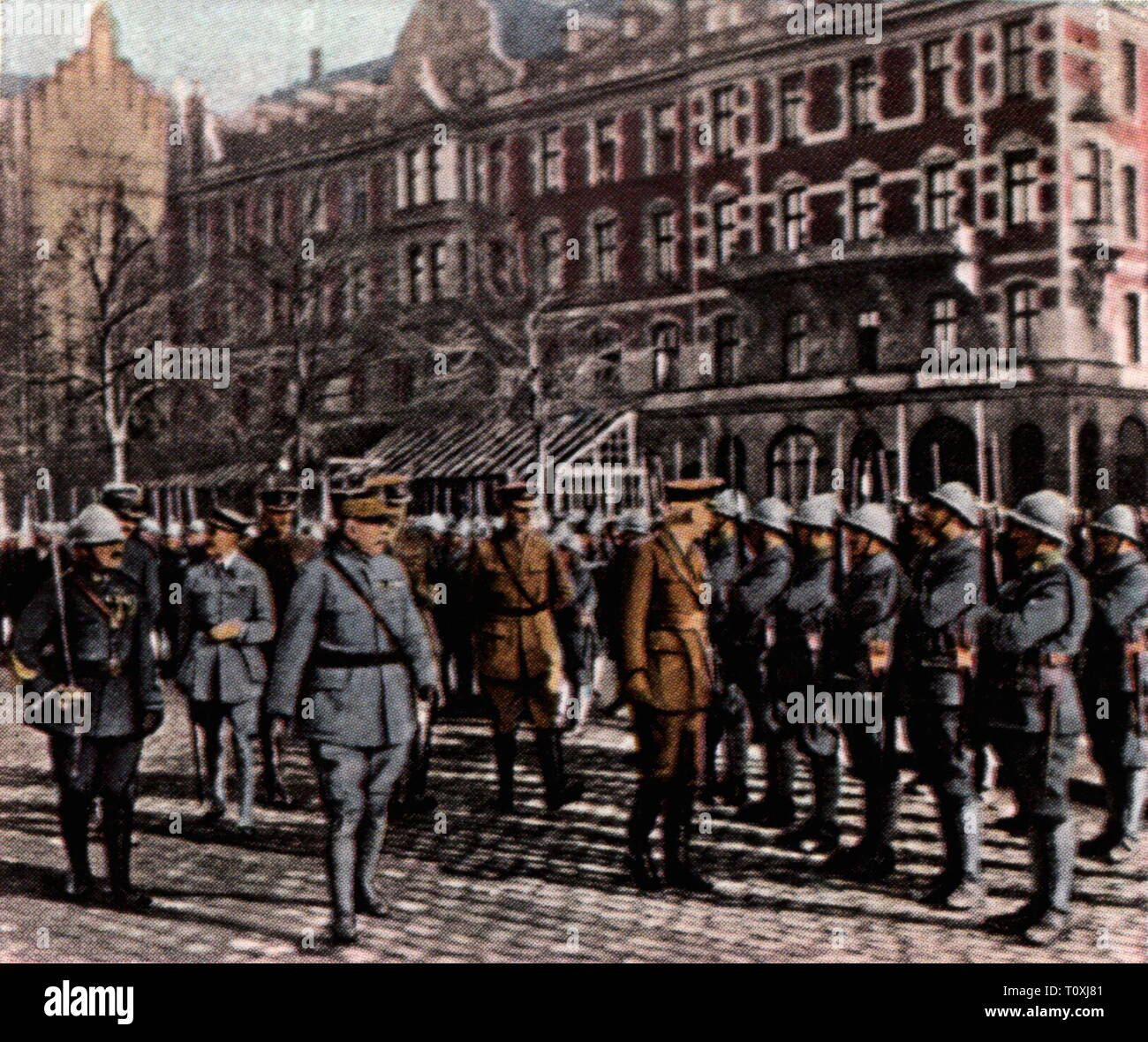 politics, Inter-Allied occupation in Gdansk, parade French troops on the Oliva-Platz, 19.2.1920, coloured photograph, cigarette card, series 'Die Nachkriegszeit', 1935, Free City of Danzig, Oliva square, free state, free states, League of Nations, clause of the treaty of Versailles, Treaty of Versailles, military, entente, French, soldiers, soldier, people, Prussia, Germany, German Reich, Weimar Republic, 1920s, 20th century, politics, policy, parade, parades, coloured, colored, post war period, post-war period, post-war years, post-war era, hist, Additional-Rights-Clearance-Info-Not-Available - Stock Image