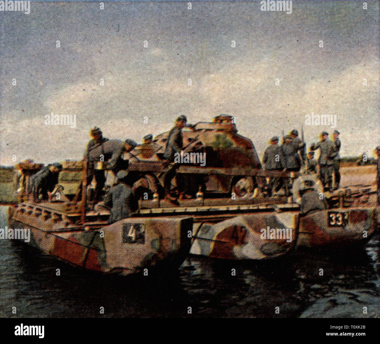 """military, Germany, army, exercises, autumn manoeuvre, September 1926, a dummy tank is transfered over a river, coloured photograph, cigarette card, series """"Die Nachkriegszeit"""", 1935, river crossing, crossing, traverse, crossings, traverses, drill, training, autumn, fall, tank, panzer, tanks, dummy, dummies, camouflage, camouflages, comouflage coating, camouflage paint, Flecktarn Camouflage, ferry, ferries, pontoon, pontoons, soldiers, soldier, Reichswehr, people, Germany, German Reich, Weimar Republic, 1920s, 20th century, army, armies, exercises, Additional-Rights-Clearance-Info-Not-Available Stock Photo"""