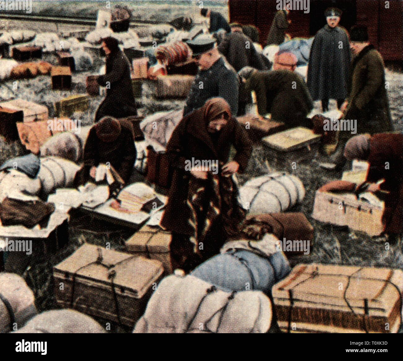 people, refugees, Volga Germans which fled the Soviet Union, Eydtkuhnen, East Prussia, December 1929, coloured photograph, cigarette card, series 'Die Nachkriegszeit', 1935, Chernyshevskoye, Russia, flight, displacement, Germans, German, USSR, Union of Socialist Soviet Republics, persecution, persecutions, Stalinism, Prussia, Germany, German Reich, Weimar Republic, people, 1920s, 20th century, refugee, refugees, coloured, colored, post war period, post-war period, post-war years, post-war era, historic, historical, Additional-Rights-Clearance-Info-Not-Available - Stock Image