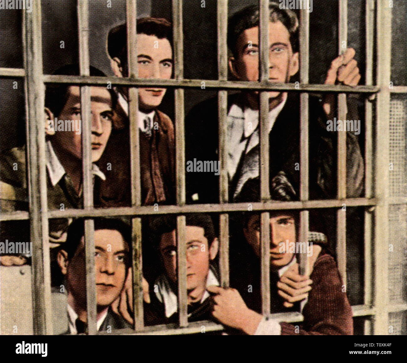 justice, penitentiary system, prison, unemployed who participated in riots are waiting for their trial, USA, 1932, coloured photograph, cigarette card, series 'Die Nachkriegszeit', 1935, unemployment, economic crisis, economic crunch, economic crises, economic crunches, world depression, world depressions, crisis, crises, captive, prisoner, prisoners, 20th century, 1930s, prison, prisons, jailhouse, jail, jails, unemployed, nonworker, workless, unemployed people, riot, riots, participate, partake, participating, partaking, USA, United States of A, Additional-Rights-Clearance-Info-Not-Available - Stock Image
