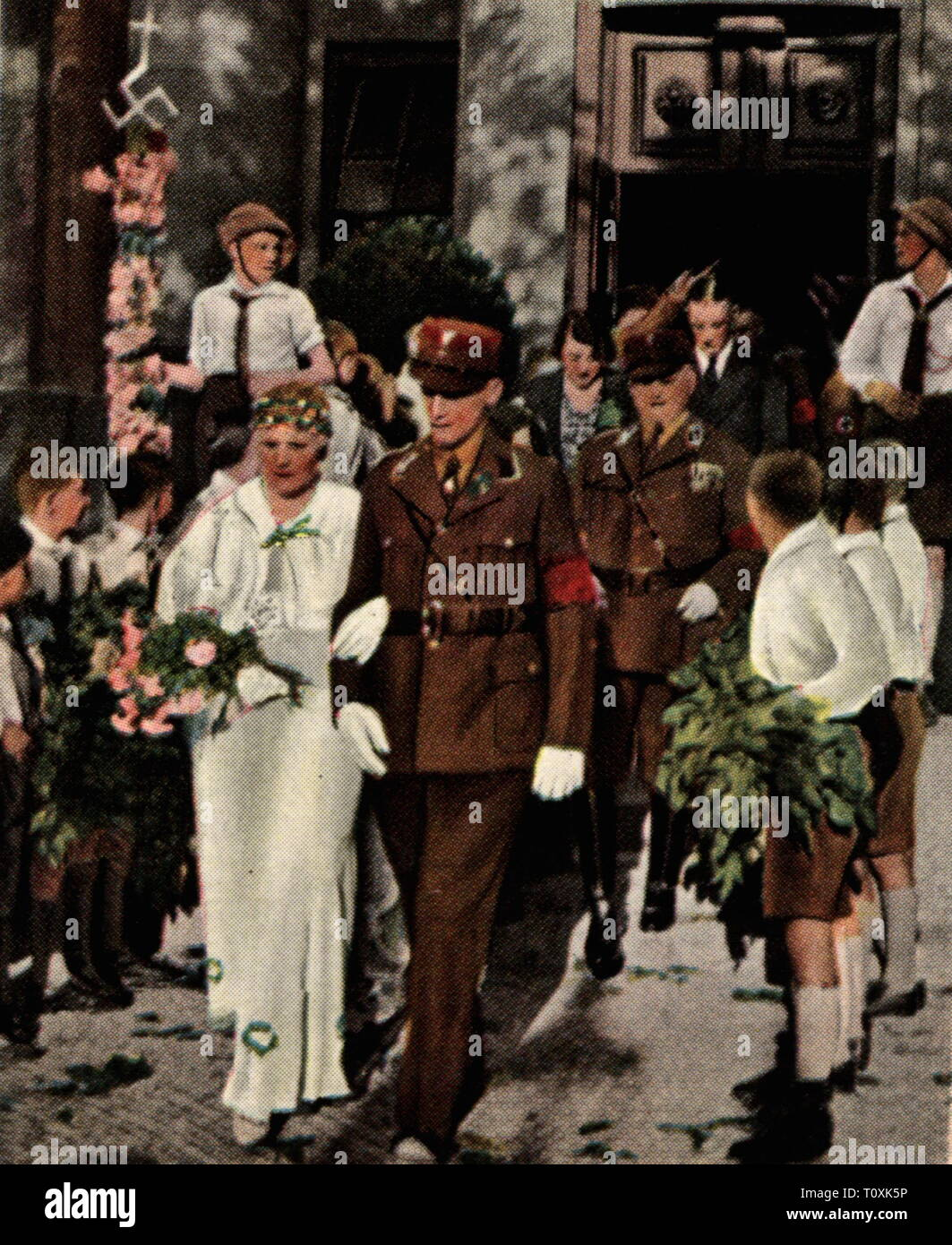 "Nazism / National Socialism, event, mass marriage by SA men, Berlin, December 1934, coloured photograph, cigarette card, series ""Die Nachkriegszeit"", 1935, Sturmabteilung, storm battalion, stormtroopers, armed and uniformed branch of the NSDAP, men, man, mass wedding, marriage, wedding, weddings, bridal couple, bridal couples, couples, couple, Nazi, Nazis, NSDAP, Germany, German Reich, Third Reich, people, 20th century, 1930s, event, events, coloured, colored, post war period, post-war period, post-war years, post-war era, historic, historical, Additional-Rights-Clearance-Info-Not-Available Stock Photo"