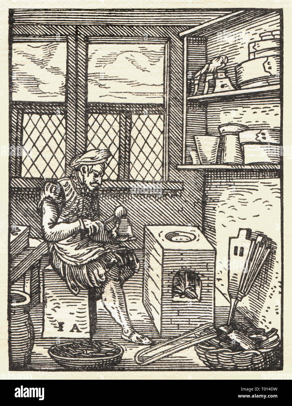 A punchcutter preparing a letter punch to produce typeface for use in letterpress printing. Woodcut by Jost Amman (1539-1591) from Das Ständebuch published in 1568. - Stock Image