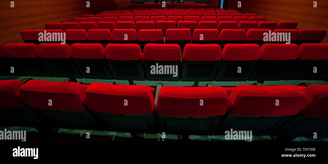 red velvet armchairs in the movie theater Stock Photo