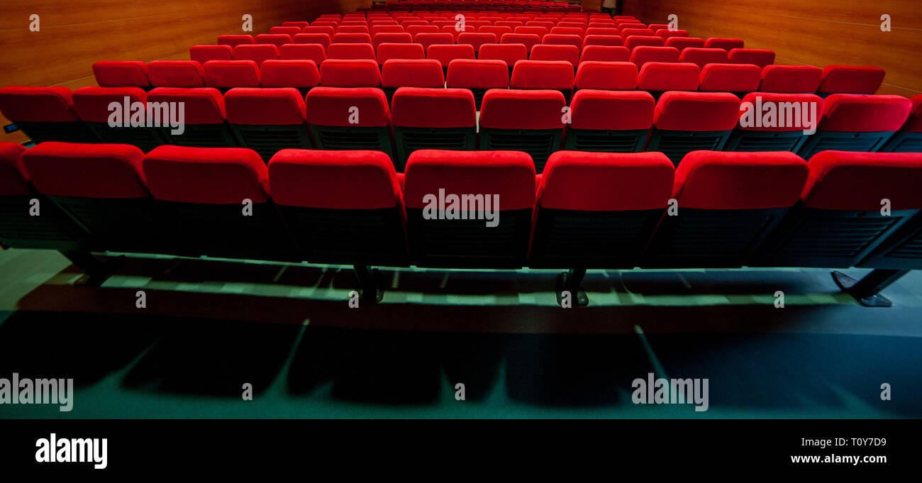 red velvet armchairs in the movie theater - Stock Image