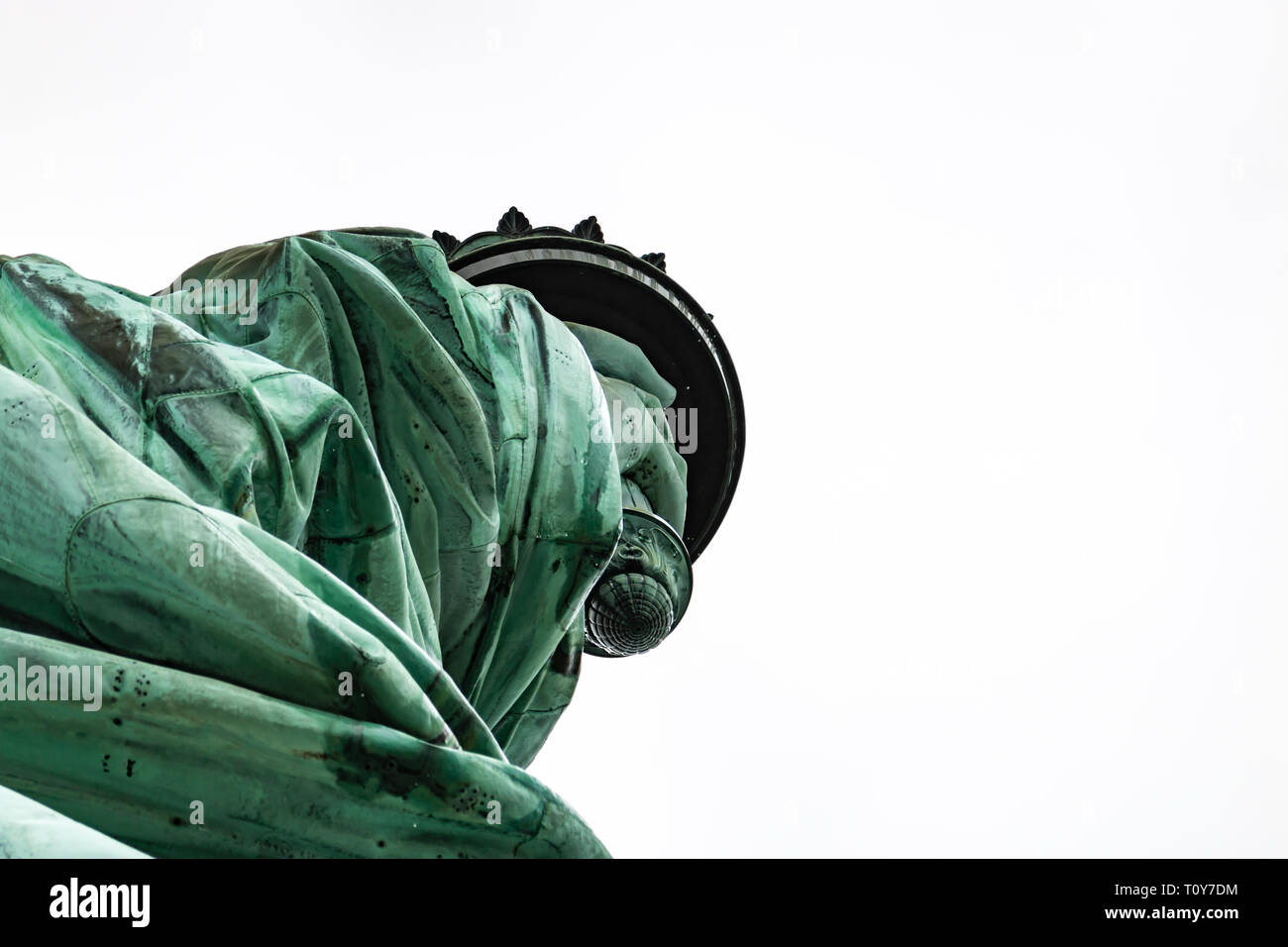 a close up of a rain-wet Statue of Liberty focussing on her arm and torch. - Stock Image