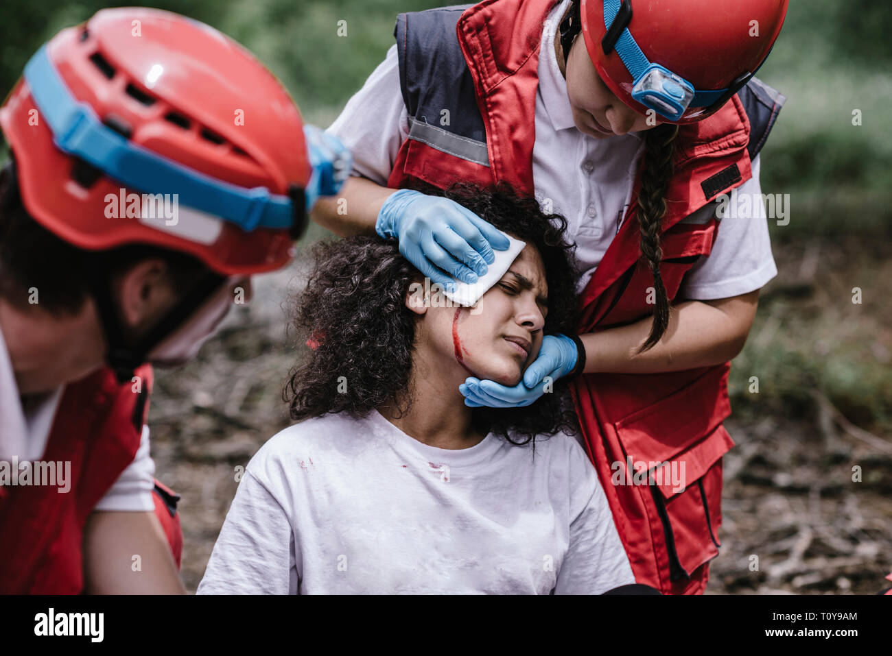 Rescue team treating injuries in the field. - Stock Image