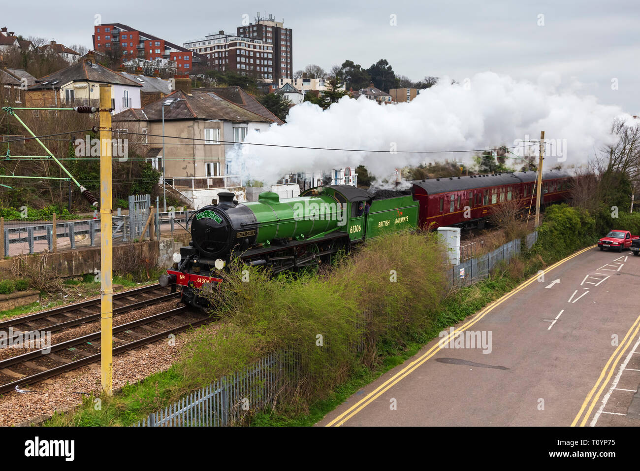 Old Leigh, Essex, UK. 23rd Mar 2019. Reserved steam locomotive 61306 'Mayflower' hurtles through Old Leigh in Essex early this morning en-route to the Bluebell railway in East Sussex. from Southend-on-Sea. 'Mayflower' is one of only 2 LNER Class B1 locomotives preserved and it only returned to mainline running last year. Credit: Timothy Smith/Alamy Live News Stock Photo