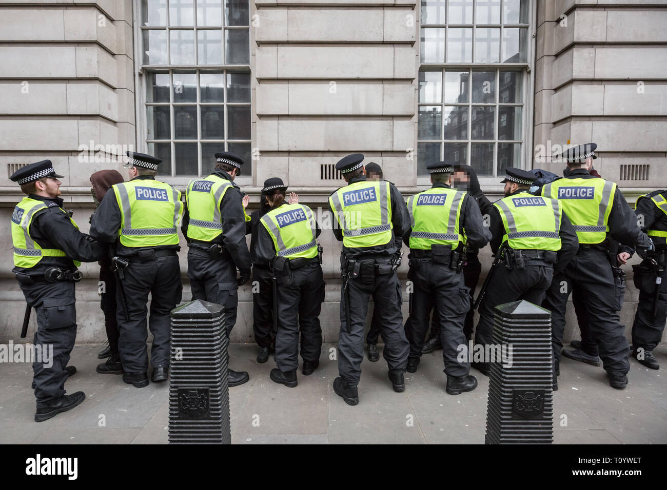 """London, UK. 1st April, 2017. Anti-Fascist groups including Unite Against Fascism (UAF) clash with police with some arrests being made whilst counter-protesting far-right British nationalist groups including Britain First and the English Defence League (EDL) during their """"march against terrorism"""" through central London in light of the recent terror attacks in Westminster. Police arrested 14 people during the clashes. Credit: Guy Corbishley/Alamy Live News - Stock Image"""