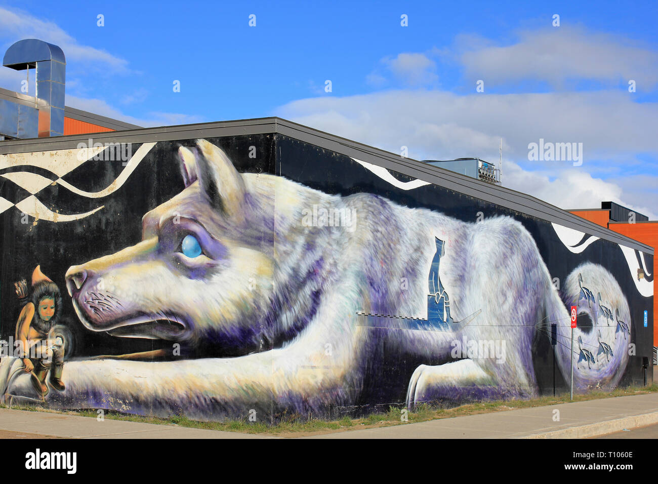 Inuit Girl and Husky Dog Art at Qikiqtani General Hospital, Iqaluit, Nunavut - Stock Image