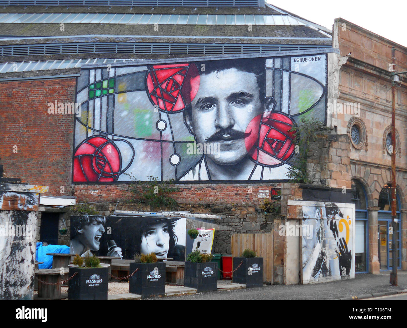 This splendid image is of Charles Rennie Mackintosh, the great Scottish architect and designer, and it is to commemorate 150 years since his birth. The image appeared on the wall behind the Clutha Bar in Glasgow in 2018. Alan Wylie/ALAMY © - Stock Image