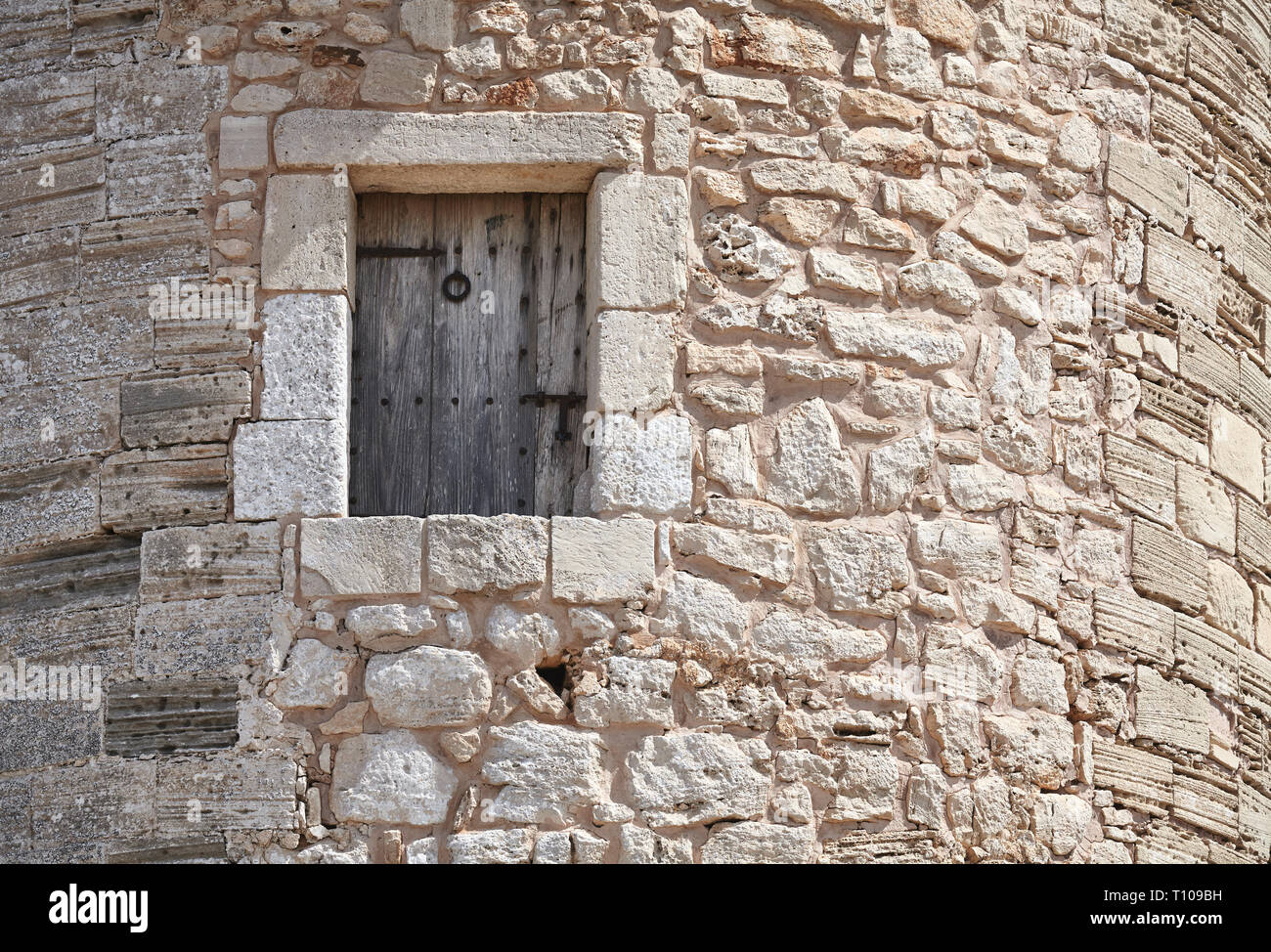 Wooden window in a medieval stone tower. - Stock Image